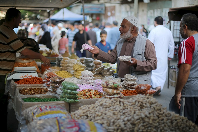 A Palestinian customer shops at a market ahead of the Eid al-Adha festival in Khan Younis in the southern Gaza Strip.
