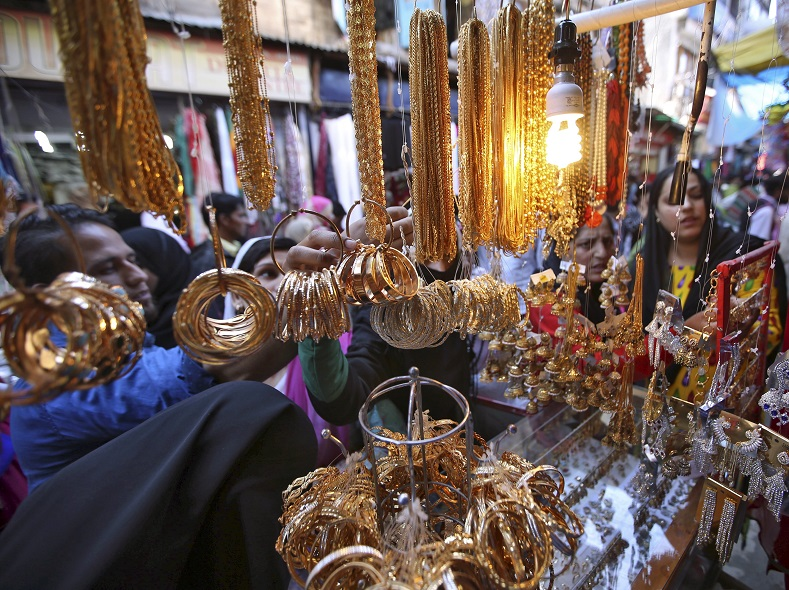 People select jewellery before buying from a vendor at a marketplace ahead of the Eid al-Adha festival in Srinagar September 23, 2015. Eid al-Adha in Kashmir falls on Friday.