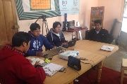 Aymara translators hard at work at their office in La Paz