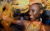 A member of the Elumbé dance troupe dances during the carnival parade, which is heavily influenced by Afro-Uruguayan folklore, Montevideo, Uruguay, Feb. 4, 2005.