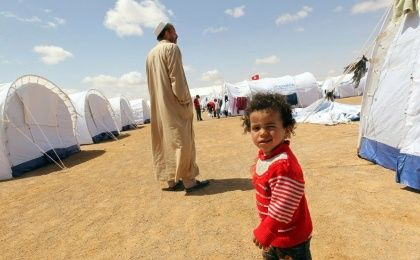 A Libyan child walks at a newly opened refugee camp for Libyan families in Ramada, some 25 km from the southern Tunisian Libyan border of Dehiba, Tunisia, 26 April 2011