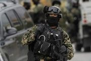 Mexican soldiers confront a group of suspected kidnappers. One soldier and five suspects died in the shootout.