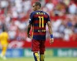 Barcelona's Neymar walks during their Spanish first division soccer match against Sevilla.