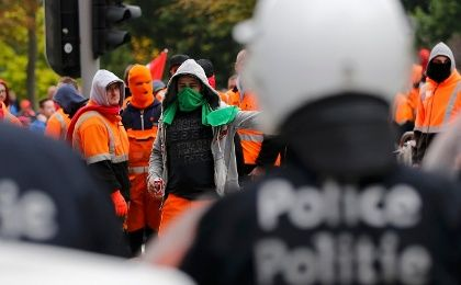 Demonstrators confront riot police in central Brussels during a protest over the government's reforms and cost-cutting measures on Oct. 7, 2015, eight days before the TTIP protest.