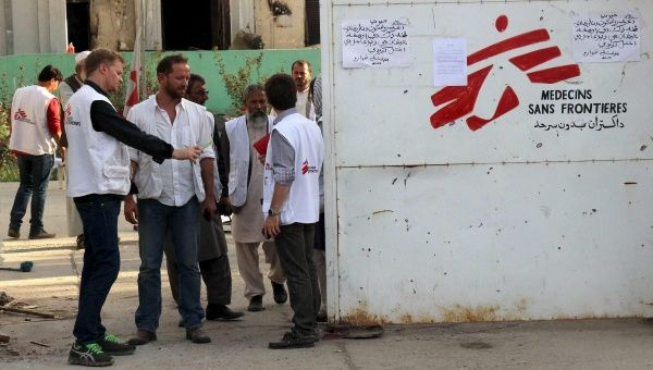Christopher Stokes (front L), general director of Medecins Sans Frontieres (MSF), stands in front of an entrance gate of the MSF hospital in Kunduz, Afghanistan.
