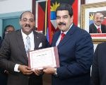 Venezuelan President Nicolas Maduro and Antigua and Barbuda Prime Minister Gaston Browne present an agreement signed between the two countries.