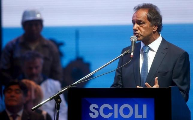 Daniel Scioli, Buenos Aires' province governor and presidential candidate for the Victory Front, speaks as vice-presidential candidate Carlos Zannini (bottom, L) watches during a campaign rally in Buenos Aires, September 21, 2015.