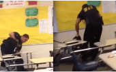 A school cop is filmed putting a high school student in a chokehold and throwing her back in her chair.