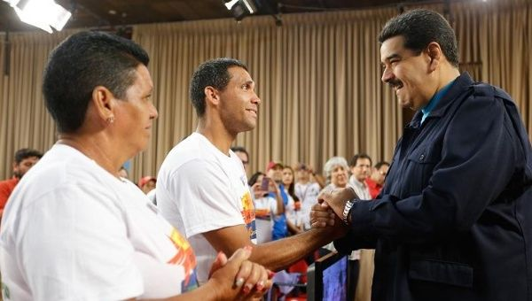 Venezuelan President Nicolas Maduro greets graduates of the Robin Mission program at an event to commemorate its 12-year anniversary, Venezuela, July 1, 2015.