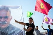 A giant picture of leader Abdullah Ocalan is seen during a demonstration in support of Kurdish forces fighting the Islamic State group.