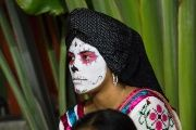 A woman from Oaxaca prepares for a parade in celebration of Day of the Dead.