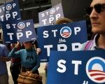 Demonstrators protest the TPP trade deal.