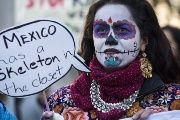 An activists protests President Enrique Peña Nieto's state visit to Britain.