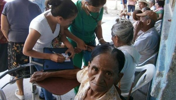 Hondurans receive care from Cuban doctors.