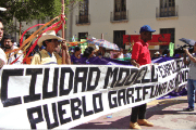 """Model Cities = Expulsion of Garífuna People of Honduras."" Resistance groups protest model cities outside National Congress in Tegucigalpa in January 2013."