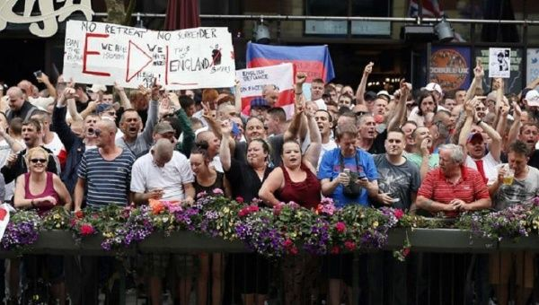 Supporters of the right-wing and anti-Islamist English Defence League (EDL) protest in Birmingham July 20, 2013.