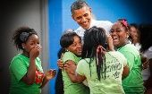 Girls hug President Barack Obama as he visits the Boys and Girls Club of Cleveland.