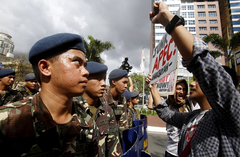 "Soldiers block members of ""Bayan"" (My Country) activist group near the U.S. embassy during an anti-APEC protest."