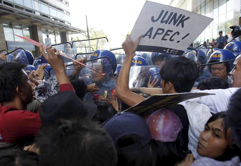 Dozens of student protesters clash with the Philippine police in an anti-APEC rally ahead of the summit.