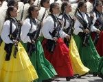 Mexican women dress as 'La Adelita' in a military parade to commemorate the women who fought in the 1910-20 Revolution.
