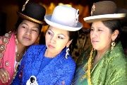 ​Aymara models look on at the fair of the Cholita garb show in Villa Esperanza.