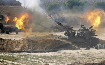 Israeli mobile artillery bombards the Gaza Strip during a 2014 offensive that left over 1,500 people dead, mostly Palestinian civilians.