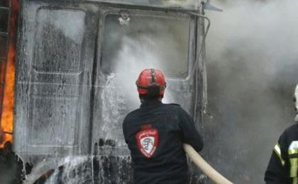 A humanitarian aid organization helps extinguish the fire from an air strike near the Syrian border.