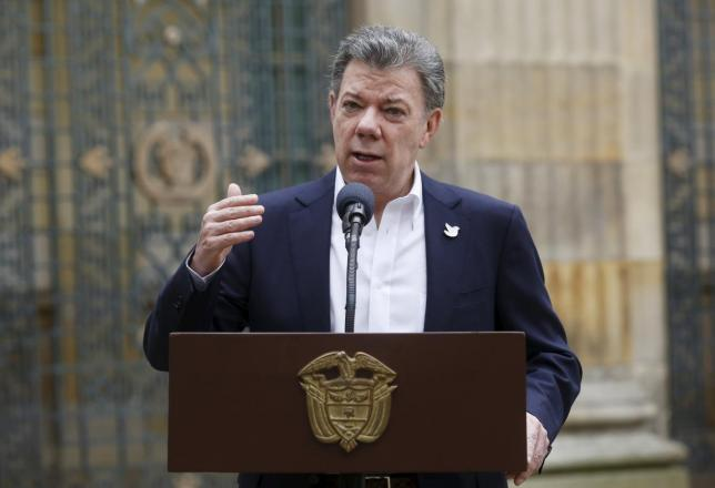 Colombia's President Juan Manuel Santos speaks after casting his vote during local and regional elections in Bogota, Colombia Oct.25, 2015