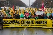 Demonstrators march in Berlin on the eve of the COP21 summit to pressure global leaders to take action on climate change.