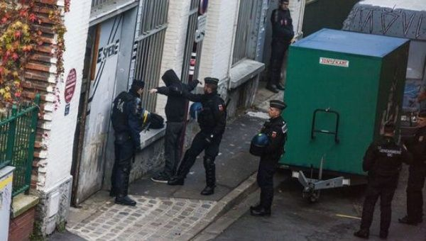 Police raid in a squad of Seine-Saint Denis, a Parisian suburb, three days before the inauguration of the COP 21.