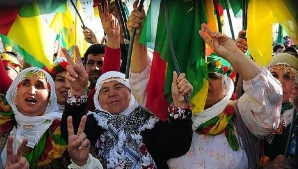 Kurdish women wave PKK flags as they celebrate Nowruz, the Persian new year.