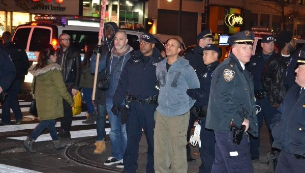 A protester is arrested during the march.