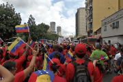PSUV supporters march towards Avenida Bolivar.