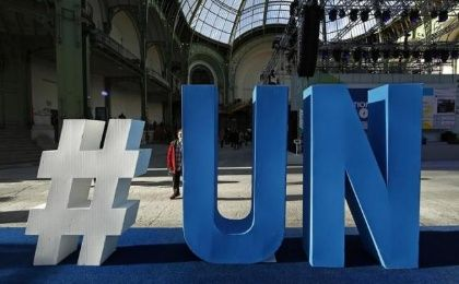 A United Nations logo is pictured at the Grand Palais during the Solutions COP21 in Paris, France, December 4, 2015 as the World Climate Change Conference 2015 (COP21) continues at Le Bourget near the French capital.