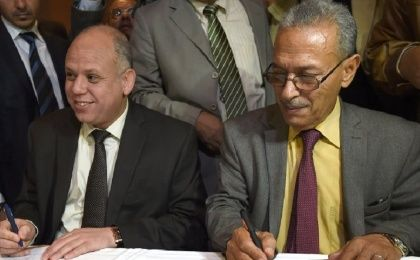 Awad Mohammed Abdul-Sadiq (L), the first deputy head of the Tripoli-based General National Congress (GNC), and Ibrahim Fethi Amish from Libya's internationally recognised House of Representatives sign peace deal.