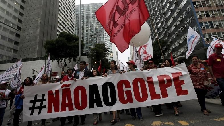 "People with a banner that reads ""No to the coup"" attend a protest against the impeachment proceedings against President Dilma Rousseff, Brazil Dec. 8, 2015."