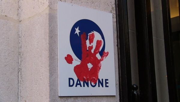Via Campesina protesters put their red hand print on Danone