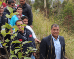 President Rafael Correa (R) and members of the Ministry of Environment attend Ecuador's record-setting tree planting event in July 2015.