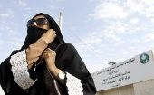A Saudi woman leaves a polling station after casting her vote during municipal elections, in Riyadh, Saudi Arabia.