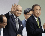 French President Hollande with Laurent Fabius President-designate of COP21, and United Nations Secretary-General Ban Ki-moon at the COP21 plenary session near Paris, France, Dec.12, 2015.