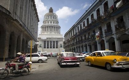 Cuba's Capitol, or El Capitolio as it is called by Cubans (rear), is seen in Havana.