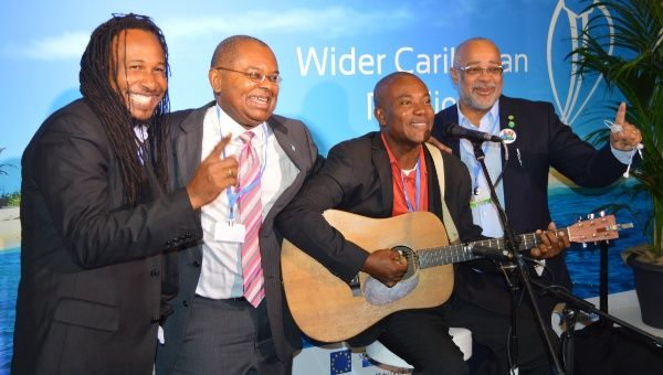 Dr. James Fletcher (2ndL) and OECS Director General Dr. Didacus Jules (R) join Caribbean artists at the Wider Caribbean Pavilion at COP21 in Paris.
