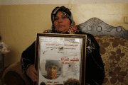 Feryal, the mother of 16-year-old Mohammed Suleiman, holds his picture at her house in the West Bank village of Hares near Salfit May.12, 2014.