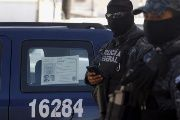 Federal police officers in the violence-wracked city of Apatzingan in the central state of Michoacan.