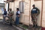 Police conduct operation in Castries, Saint Lucia. The country's police force has been under intense scrutiny following allegations of extrajudicial killings.