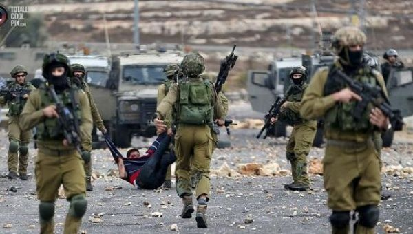 Israeli soldiers detain a wounded Palestinian protester during clashes near the Jewish settlement of Bet El, in the West Bank.