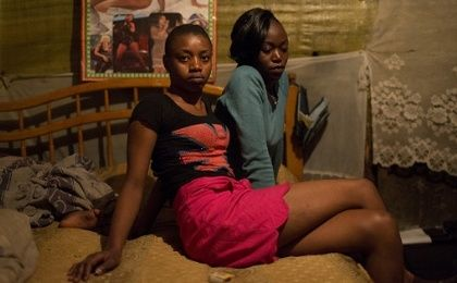 Sex workers Alice, 20 (L) and Claire 17, pose for a photograph in their home in Kiamaiko, Nairobi, June 16, 2015.