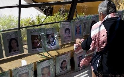 A mother places a picture of her disappeared son at the ninth caravan of women that ended on Saturday in Chiapas.