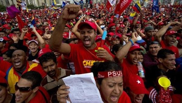 Supporters of Venezuelan President Hugo Chavez attend his campaign closure rally in Caracas, on October 4, 2012.