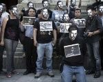 Mexican protesters wear Ruben Espinosa masks, a Mexican photographer and journalist who was killed in his Mexico City apartment July 31, 2015.